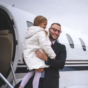 Charter Flights - Man and daughter on private jet.