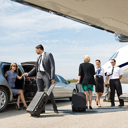 FBO Services - Business people boarding private jet
