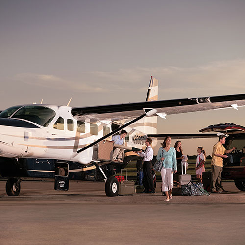 FBO Services - Family disembarking from aircraft